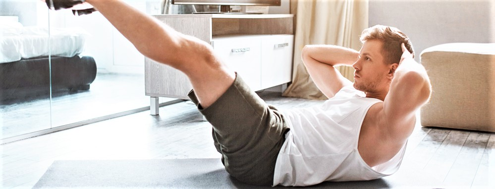 man working out at home crunches